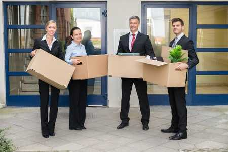 employees holding office moving boxes in Miami